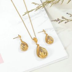 Gentle petals of water Lilly are beautifully nested on the diamonte water drop, Stunning floral Pendant and Stud Earrings with warm coral shades of petals. Buy Now! Pendant Earrings, Gold Necklace, Stud Earrings, Watches Online, Earring Set, Jewelry Stores, Costume Jewelry, Coral, Rose Gold