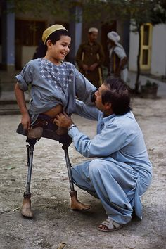 What an electric picture! This kid has many reasons not to smile and yet he glows! Steve McCurry photograph - AFGHN-10118NF