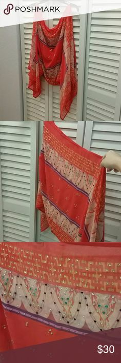 Ranee's One Shoulder Coral Morrocan Top Embellished top. Morrocan/Indian inspired top. Super fashion forward. Can be worn on the shoulders or as a one shoulder. Beading in the front with exotic red purple print. A few stones missing but unnoticeable Ranee's Tops