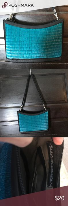 """Baskets of Cambodia teal straw bag Baskets of Cambodia teal straw bag. Never used. Approx 9x6"""". 1 inside zip pocket and 2 flap pockets. Baskets of Cambodia Bags"""