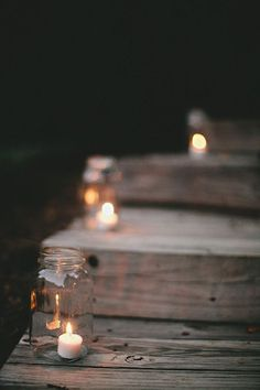 Simple outdoor decorations using mason jar and candles to light up paths: