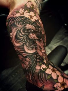 What does japanese tiger tattoo mean? We have japanese tiger tattoo ideas, designs, symbolism and we explain the meaning behind the tattoo. Japanese Tiger Tattoo, Japanese Tattoo Designs, Japanese Sleeve Tattoos, Japanese Forearm Tattoo, Japanese Tattoo Sleeve Samurai, Tattoo Japanese Style, Japan Tattoo, Photo Tigre, Bicep Tattoo Men