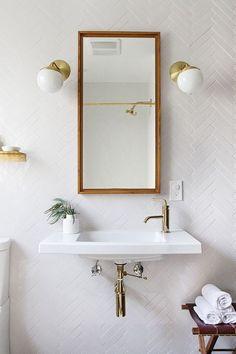 Crisp white, mid-mod bathroom inspiration.