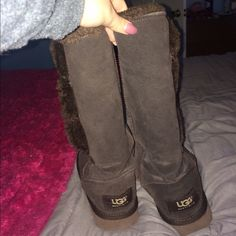 Tall bailey button uggs. Dark brown Only flaw is missing one button. Easy to fix, if not sold this week I will fix them and raise the price. UGG Shoes Winter & Rain Boots