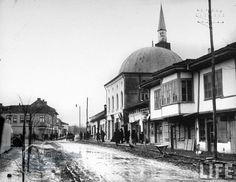 on muddy street in main part of town. Moldova, Mosque, Bulgaria, Alter, Old Photos, Taj Mahal, Maine, Ottoman, History
