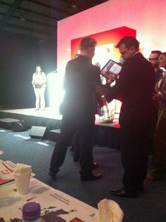 Tim is about to receive award (UK & ROI Owners Meeting 2013)