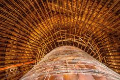 Plagmann Round Barn, Marengo, Iowa // 85' diameter, 3 story barn built in 1912 of clay tile considered the largest round barn in Iowa. The first story was for cattle, second story had 30 horse stalls, and the 110,000 cubic ft 3rd story loft held 200 tons of hay. central silo is 20' diameter and 45' tall (60 feet to top of barn). Second Story, First Story, Clay Tiles, Horse Stalls, Cattle, Iowa, Horses, Gado Gado, Horse