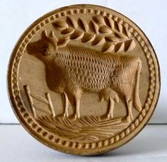 """Small 2.75"""" dia. X 3.75 h. 19th century finely carved butter print with a cow grazing near a fence. There is a well carved border around the cow. Sold 11/8/15 on ebay for $238 by hammi9."""