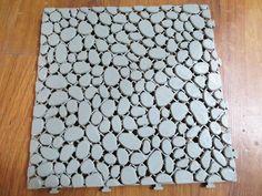 Vỉ nhựa lót sàn hình viên sỏi - 27.000đ/vỉ