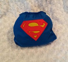 Superman cloth diaper for your little superhero. Art is stitched (appliquéd) onto an outer cotton layer and does not interfere with the