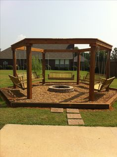 Outdoor fire pit with swings