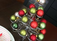 Cupcake stand with ornaments, add some green branches to fill.