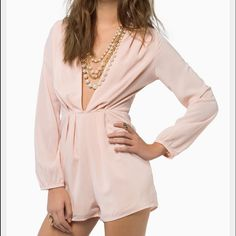 Tobi Melina Romper NWOT in Cream NWOT- I've had this hanging in my closet but it's never been worn, only tried on! Tags are taken off. This romper is so cute for spring with wedges or heels for a going out look. Photos are not me wearing the romper, others I have found so you can see what it looks like on! Tobi Pants Jumpsuits & Rompers