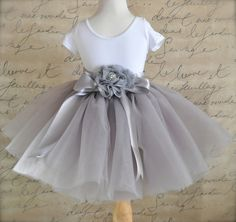 Dove grey Flower Girl short 8 layer tutu with silver satin ribbon sash waist. Sewn, no tied knots.. $78.00, via Etsy.