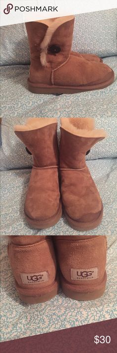 Bailey Button Chestnut Uggs Bailey button chestnut Uggs. Used condition. Some water stains shown in pictures. Smoke free home. Price negotiable, no trades. UGG Shoes