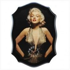 Marilyn Monroe Wall Clock  The timeless beauty and grace of the legendary Marilyn Monroe takes center stage on this utterly stunning decorative clock Shown here in a gorgeous golden gown and sultry pose. $59.95