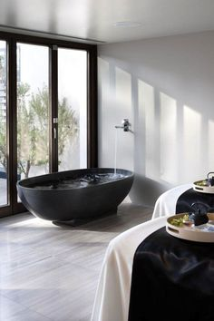 Saffire Freycinet Lodge Australia Black Bathtub Remodelista-floor tiles