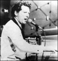 Jerry Lee Lewis (American rock and roll and country music singer song writer pianist) His act was considered the rawest rock and roll act of all time, he'd kick aside the piano bench, rake his fingers up and down the key board, shake like a wild person, sit and even stand on the keyboard at points. Known for his songs Great Balls of Fire, Breathless, Good Golly Miss Molly, Whole Lotta Shakin Goin On. . . . ..
