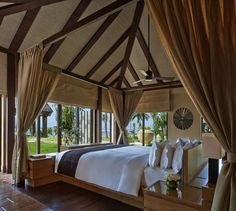 Overlooking the ocean in Nusa Dua, The Ritz-Carlton, Bali is a luxury hotel with spacious suites, pool villas and a beautiful glass wedding chapel. Hotel Suites, Hotel Spa, Hotel Guest, Commercial Interior Design, Commercial Interiors, Vaulted Ceiling Bedroom, Hotels And Resorts, Luxury Hotels, Luxury Travel