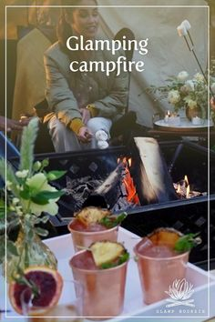 Once the sun begins to go down, the campfire becomes the centerpiece of your glamping experience. Elevate your night around the fire with crafted cocktails, cozy blankets and chairs, and even a savory twist on campfire s'mores. Get more inspiration for your next outdoor dining experience at glampboursin.com. #glampboursin Cozy Blankets, Outdoor Dining, Glamping, Centerpiece, Cocktails, Chairs, Backyard, Fire, Sun