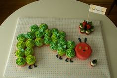 "The very hungry caterpillar cake! This is a great use of cupcakes into a ""cake""."