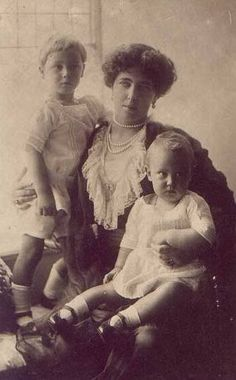 Infante Alvaro, san curls, with his mother Duchess Beatrice and little brother Infante Alonso.