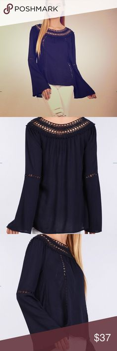 Coming Soon! Bella Navy Top This Bella Blue solid navy long bell sleeve top is super cute! Boat neck. Crochet Trim. Hi-lo hem. Pair with cropnor skinny jeans and Booties and YOU ARE SET! 💗💗 Tops Blouses
