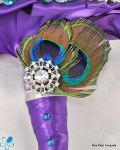 Peacock Brooch Bouquet - Blue Petyl Bouquets for the flowers for the girls