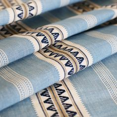 A beautiful, woven striped fabric in sky blue, navy and creamy white. Suitable for upholstery, drapery, curtains, roman blinds, cushions, pillows and other hom