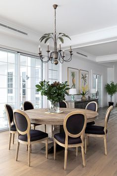 Classic wooden and black round dining area in open plan Hamptons-inspired home. Interior Design, Dining Chairs, Black Dining Room, Round Dining Room, Black Round Dining Table, Home, Hamptons Style Decor, French Dining Chairs, Hamptons Style Homes