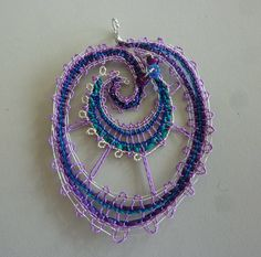 Handmade bobbin lace pendant with silver wire and by LarrikinLace