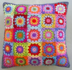 a patchwork crochet granny square cushion cover by handmadebyria
