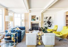 Colorful living room with yellow armchairs and blue sofa