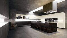 Cesar Kitchens model ELLE.  On this picture you can see how the 45 degree edges meet perfectly in the central island that appears like a monolithic block, also thanks to its precious ebony evenly-distribuited grain that allows the wood grain to embrace the perimeter of the island without interruptions.  www.cesar.it - www.togninarredamenti.eu - TOGNIN ARREDAMENTI authorized dealer.