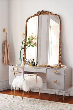 Vintage gilt mirror on dresser. Loving the dark blush and gold theme