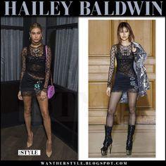 Hailey Baldwin in sheer black mini dress with pink leather bag
