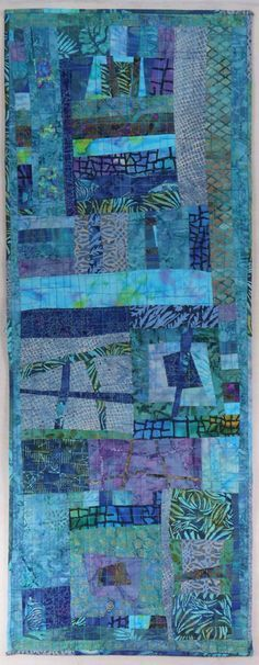 Turquoise table art by Kathie Briggs- good way to practice improve piecing in one color way-table runner nice size and easy to machine quilt