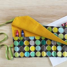 Battle boredom even when you're on the go with this handy crayon organizer roll up.