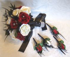 Wedding bouquet set dark red and white roses black feathers crystal gems bridal bouquets and boutonnieres. $188.00, via Etsy.