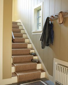 Stairs lead to the guest quarters over the garage.
