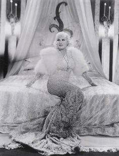 Mae West- Goin' to Town, 1935. Costumes by Travis Banton...Wow imagine this for  as start for a winter wedding ensemble.