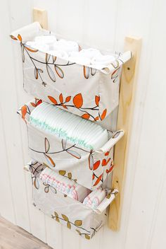 Wall hanging storage - with 3 baskets - Light beige with orange - white - green leaves, branches on Etsy, $70.00