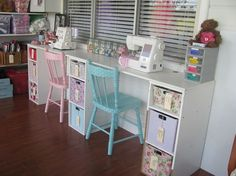 vintage sewing room *maybe serger at one and sewing machine at the other*