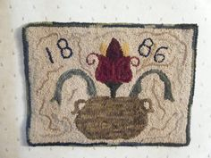 Primitive hand hooked wool rug by A Pug's Rug