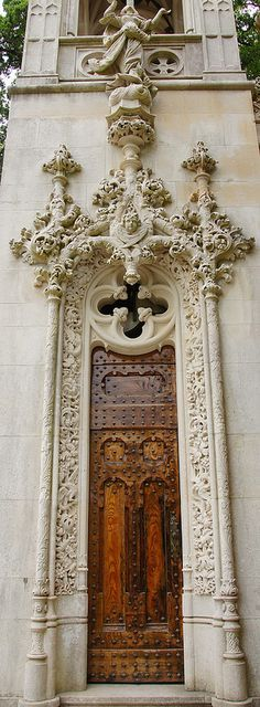An ornately-embellished wooden for in Sintra, Portugal. Door to the World. Many centuries of human existence provided us with incredible historic places! Let's remind them! ♥ Discover the news about architecture all over the world! | Visit us at http://www.dailydesignews.com/  #worldarchitecture #architecture #monuments #celebratearchitecture #architects