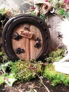 "Fairy Doors are hand made from horseshoe that are painted black and the barn wood is over 100 years old with wire hinges, door knob is made of wood and painted black. I love creating new Fairy Doors! This door is for a girl at the horse barn with her horses name on the sign. ""Tandy"""