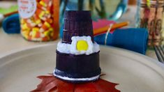 """Make a Thanksgiving Pilgrim's Hat Cornucopia - this cooking craft is delicious and perfect for kids of all ages! With just the right combination of practical, entertaining and surprising fun tablescaping, you'll be able to create a Thanksgiving kids' table your kids will be thankful for! They'll love to help you make this fun holiday treat as well.  Click in for the full how-to, ingredients and tips, along with other fun """"kids' table"""" tablescaping ideas!"""