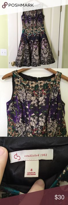 Floral Fit and Flare Dress Fit 'n flare style dress. Tones of green, purple, and more. Perfect for a garden party! Zip up in back. Only worn once. Unsure of brand, so photo of tag is posted. Anthropologie Dresses Midi