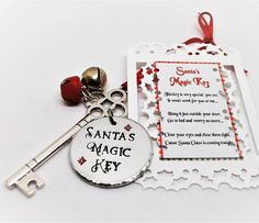 Santas magic key for the kids on Christmas Eve!! Comes with a short poem and in a red organza gift bag. Click on my website to see more. #santasmagickey #santakey #christmaseve #christmasevebox #christmasevefun #christmasevegift #nightbeforechristmas #skeletonkey #bells #ribbon #christmasiscoming #etsyperfect #etsyuk #handstamped #handmadegifts #key #handmadealphas #etsysuccess #etsyukseller