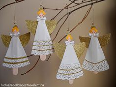 angels - made from wooden chopsticks (?) and paper lace doily.